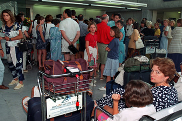 Commuters wait in the Nice airport where a strike by tarmac staff and luggage handlers forced France..