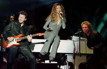 The renowned singer Celine Dion (C) performs her first Asian tour concert at the former Kai Tak airp..