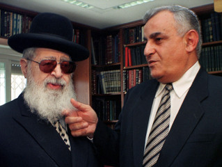 YITZHAK MORDECHAI TOUCHES BEARD OF SHAS RABBI OVADIA YOUSEF IN FILE PICTURE FROM JERUSALEM.