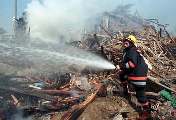 FIREMAN EXTINGUISH A FIRE IN PRISTINA.