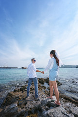 Pre Wedding photo of romantic Thai couple on seaside.
