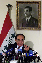 Iraqi Foreign Minister Mohamed Saeed Al Sahaf (L) speaks during a news conference in Baghdad January..