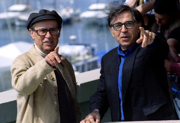 Italian directors, brothers Vittorio (L) and Paolo (R) Taviani point towards phototgraphers after th..