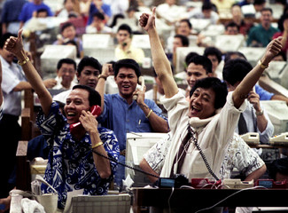 Filipino brokers at the Manila Stock Exchange in the financial district of Makati on December 29 sho..