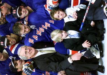 WAYNE GRETZKY WITH SONS AND COACH.