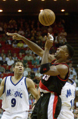 BLAZERS PIPPEN BATTLES MAGIC ARMSTRONG FOR BALL.
