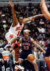 BULLS BROWN LOSES CONTROL OF BALL AFTER FOUL BY NETS MARBURY.