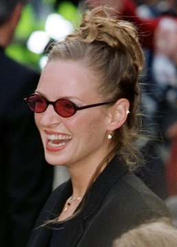 American actress Uma Thurman smiles as she arrives for the London premiere of her new hit movie Batm..