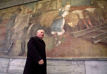 GERMAN FINANCE MINISTER LAFONTAINE PASSES PAINTING IN BERLIN.
