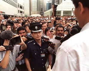 SINGAPORE OPPOSITION LEADER WARNED BY POLICEMAN AGAINST PUBLIC SPEAKING.