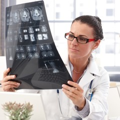 Portrait of female doctor with x-ray image in hand
