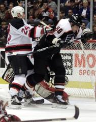 DEVILS ODELEIN SHOVES FLYERS LINDROS IN NHL GAME.