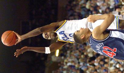 UCLA'S MOISO SHOOTS OVER ARIZONA'S BRAMLETT.