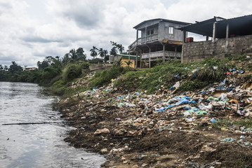 Rubbish and pollution on the banks of a river