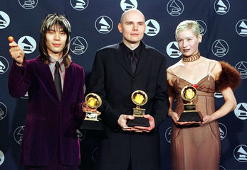 The band Smashing Pumpkins (from left) James Iha, Billy Corgan, and D'Arcy pose with the Grammy they..