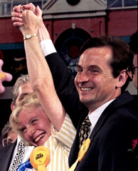 Liberal Democrat Chris  Davies (L) and his wife Carol celebrate his victory in the Littleborough and..