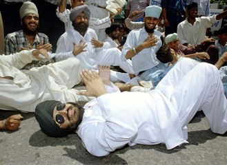 Indian Sikh protesters in New Delhi shout slogans as they demonstrate against a reported ban on the ..