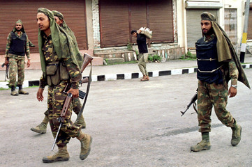 Indian troopers patrol a street of Pahalgam in Kashmir on July 24, from where five Westerners were k..