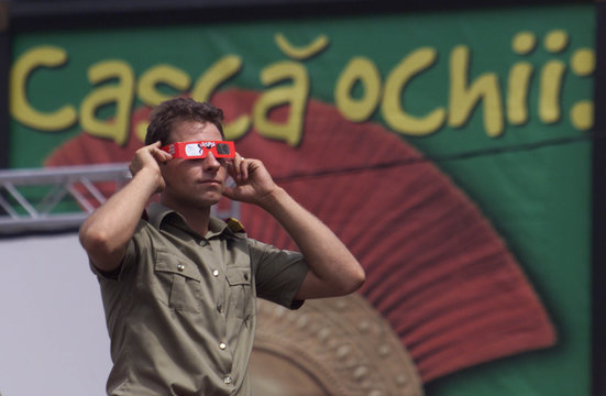 A ROMANIAN FIREMAN WITH PROTECTION SUNGLASSES DURING THE LAST TOTAL SOLAR ECLIPSE OF THE MILLENNIUM.