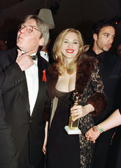Director Alan Parker (L) shows off the lipstick left by a kiss from Golden Globe winner Madonna, as ..