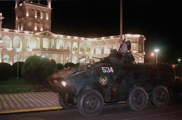 PARAGUAYAN ARMY TROOPS GUARD GOVERNMENT PALACE IN ARMORED ASSAULT CAR.