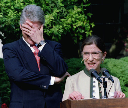 President Clinton laughs at a remark made by Ruth Bader Ginsburg, who is on her way to the US Suprem..