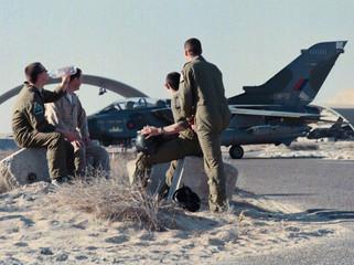British Royal Airforce pilots sit near the tarmac of an airbase near the Iraqi border December 20. T..