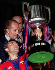 FC Barcelona's Bulgarian Hristo Stoichkov raises the Spanish Cup as King Juan Carlos (L) looks on af..