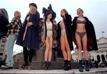 A group of young girls participating in a Miss Protest contest pose in their underwear in front of S..