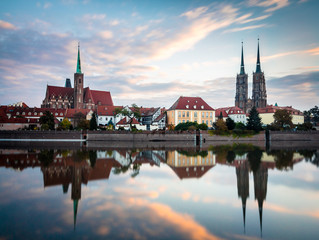 Wroclaw, Poland 22nd october 2016. Panoramic view of Ostrow Tumski in Wroclaw at sunrise with beautiful clouds in the sky. Ostrow Tumski (Cathedral Island).