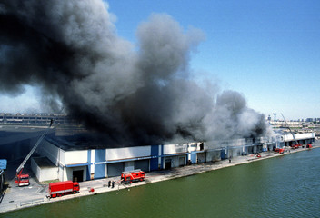 Smoke billows into the sky as a French railways (SNCF) warehouse in an industrial estate in the nort..