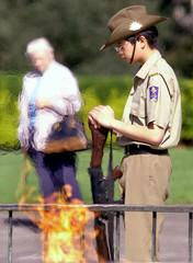HIGH SCHOOL MILITARY CADET MAINTAINS SOMBRE VIGIL NEAR ETERNAL FLAME DURING BATTLE OF AUSTRALIA ...