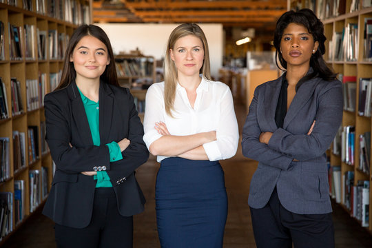 Young bright diverse legal attorney group stand powerful with confident success expression