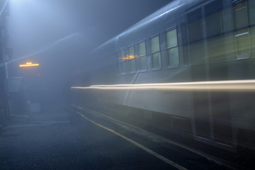 Fotobehang Treinstation A station in the fog - Italy