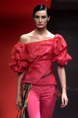 A MODEL FOR CHRISTIAN LACROIX AT SPRING/SUMMER 2000 READY-TO-WEAR FASHION SHOW.