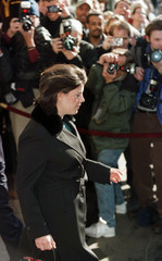 Monica Lewinsky leaves Washington's Mayflower Hotel January 26 for the airport after spending 3 days..
