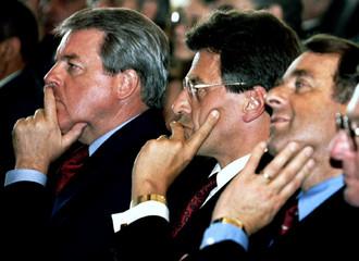 Austrian Chancellor Franz Vranitzky (L) sits next to Austrian and Swiss Transport Ministers Viktor K..
