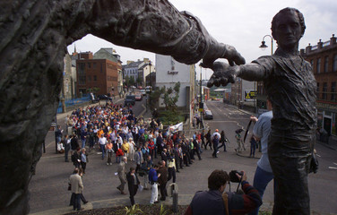 A small group of Protestant Civil rights marchers pass the hands of peace as they leave Londonderry,..