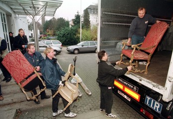 Movers carry chairs of the presidential office from Bonn to Berlin, November 19. The presidential of..