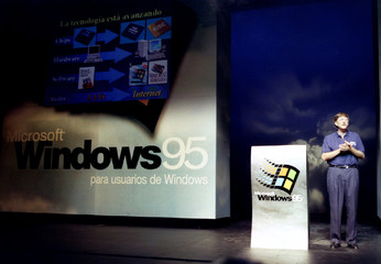 Bill Gates, chairman of software giant Microsoft, stands on stage during the launching of the new Wi..