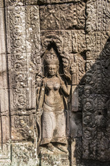 Khmer devata guarding the temple shown in stone in Banteay Kdei temple in Angkor, Siem Reap, Cambodia.