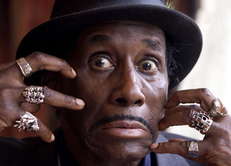 U.S. blues musician Screamin' Jay Hawkins grimaces at the official opening of the 1999 Guinness Blue..