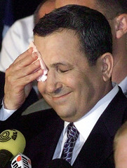 Newly-elected Prime Minister of Israel Ehud Barak wipes his face as he is overcome with emotion at a..