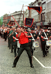 Orangemen march through the centre of Belfast July 12. A series of contentious marches have been eit..