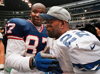 COWBOYS SMITH CONGRATULATED BY GIANTS CROSS.