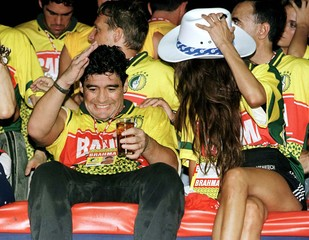 Argentine soccer superstar Diego Maradona falls backwards while watching the carnival parades at the..