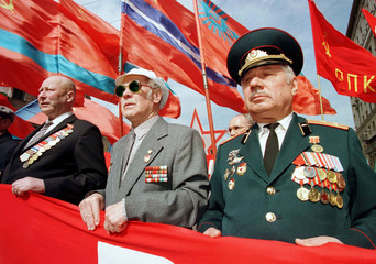 Elderly Russian WW II veterans with Soviet era red flags march through central Moscow during  Victor..