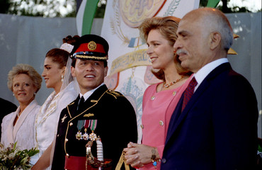 Jordan's King Hussein and his American born wife Queen Noor (R) and his eldest son Abdullah with his..