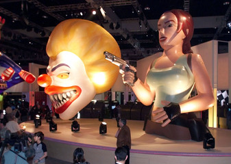 Giant, inflatable computer game characters, including an amazon like warrior named Lara Crofton (R) ..