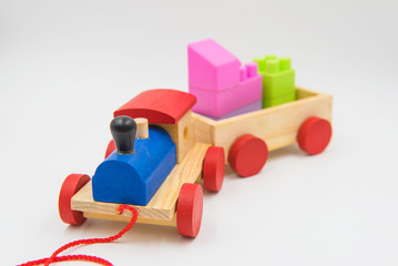 Toy train made of colorful wood on a white background.